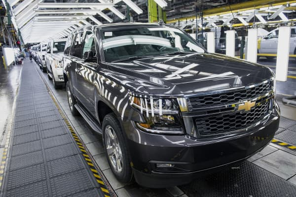 Chevrolet Tahoe sports utility vehicles (SUV) wait for final inspection before being driven off the production line at the General Motors Co. (GM) assembly plant in Arlington, Texas.