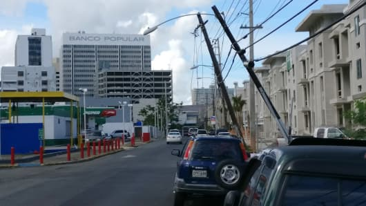 Damaged power lines hang over a street in San Juan, Puerto Rico.