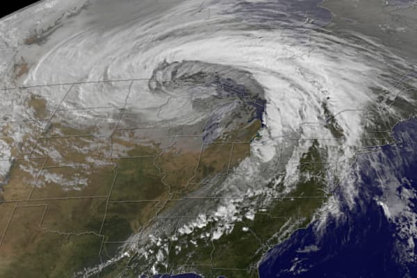 File photo of a bomb cyclone developing over the Midwest US.
