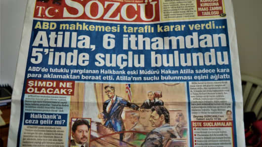 A photo taken in Ankara, Turkey on January 4, 2017 shows Sozcu, a Turkish opposition daily newspaper, appearing with a headline on its front page that reads 'Atilla was convicted on 5 of 6 counts' after a New York jury convicted Mehmet Hakan Atilla, former deputy manager of the Turkish Halk Bank, on 5 of 6 counts on January 3 of taking part in a billion-dollar scheme to evade American sanctions against Iran that strained relations between the U.S. and Turkey.