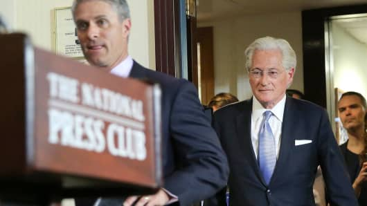 Former Trump legal spokesman Mark Corallo (left) and President Donald Trump's personal attorney Marc Kasowitz arrive to the National Press Club in Washington to read a statement to members of the media, Thursday, June 8, 2017.