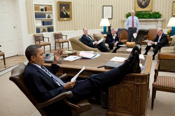 President Barack Obama holds a meeting with Vice President Joe Biden and his advisers in the Oval Office of the White House on Feb. 10, 2011.