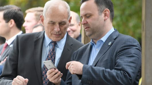White House Director of Social Media and Assistant to the President Dan Scavino Jr. shows a message on his iPhone to White House Chief of Staff John Kelly as U.S. President Donald Trump tours the U.S. Secret Service James J. Rowley Training Center on October 13, 2017 in Beltsville, Maryland.
