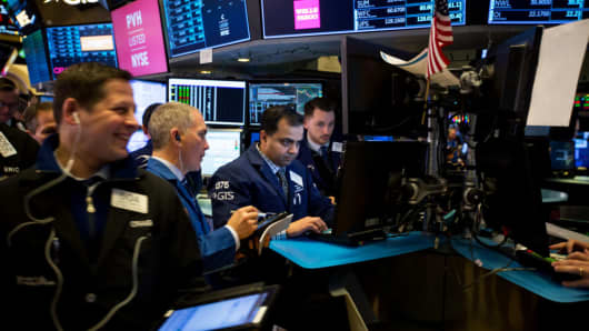 Traders work on the floor of the New York Stock Exchange (NYSE) in New York, U.S., on Tuesday, Jan. 2, 2018.