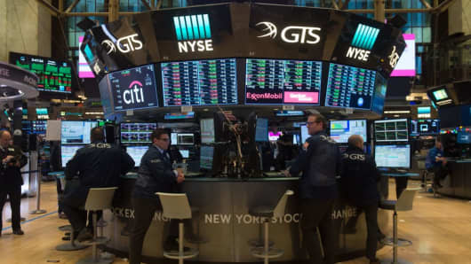 Traders work on the floor at the closing bell of the Dow Industrial Average at the New York Stock Exchange on January 2, 2018 in New York
