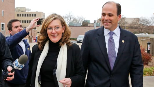 In this Wednesday, Dec. 20, 2017, file photo, Republican incumbent state Del. David Yancey walks with campaign manager Gretchen Heal outside the Newport News Courthouse in Newport News, Va.