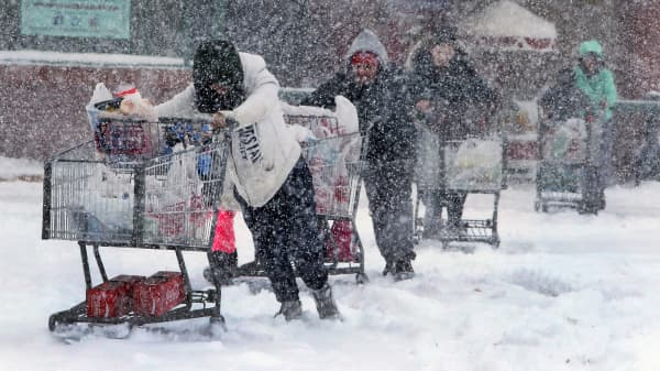 Shoppers brave the snow to stock up on items at the Market Basket grocery store on Pleasant Valley Street in Methuen, MA.