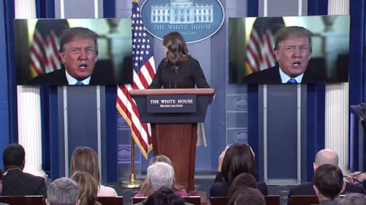 President Donald Trump makes an appearance via monitors during Sarah Huckabee Sanders daily press briefing on Jan. 4th, 2018.