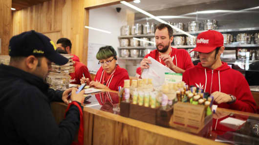 MedMen store employees serve customers buying marijuana in West Hollywood, California U.S. January 2, 2018.