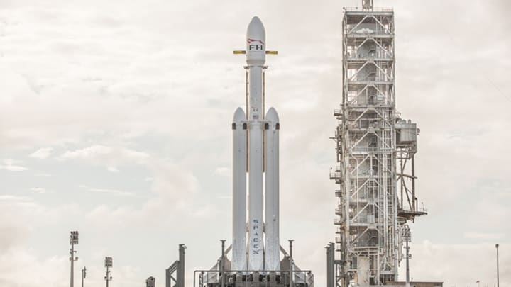 SpaceX Falcon Heavy sat on a launch pad.