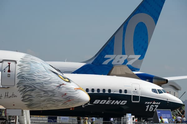 Embraer and Boeing jetliners stand on the Tarmac of Le Bourget on June 18, 2017 on the eve of the opening of the International Paris Air Show.