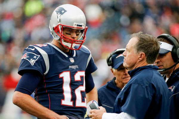 Head coach Bill Belichick of the New England Patriots talks with Tom Brady #12 during the fourth quarter of a game against the Los Angeles Chargers at Gillette Stadium on October 29, 2017 in Foxboro, Massachusetts.