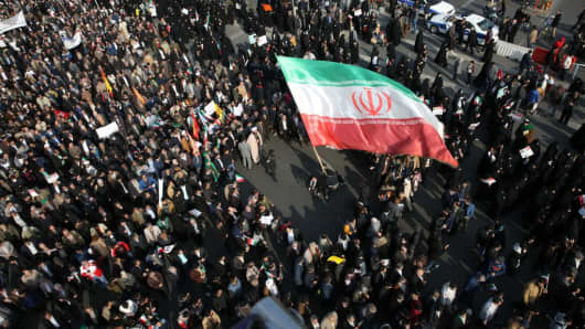 Thousands of Iranians hold banners and posters as they take part in a pro-government rally in Mashhad, Iran on January 4, 2018.