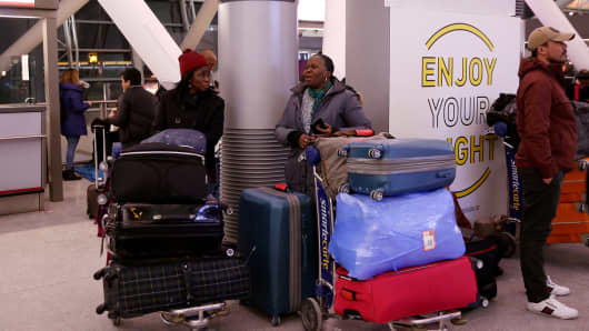 Passengers with their luggage are seen during the weather-related cancellation at the John F. Kennedy Airport in New York, United States on January 08, 2017.