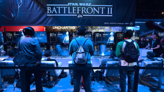 Gaming fans play 'Star Wars Battlefront II' from EA Sports at the Los Angeles Convention Center on day one of E3 2017, the three day Electronic Entertainment Expo, one of the biggest events in the gaming industry calendar, on June 13, 2017 in Los Angeles, California.