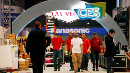 Workers walk through Las Vegas Convention Center lobby as they prepare for the 2018 CES in Las Vegas, January 5, 2018.
