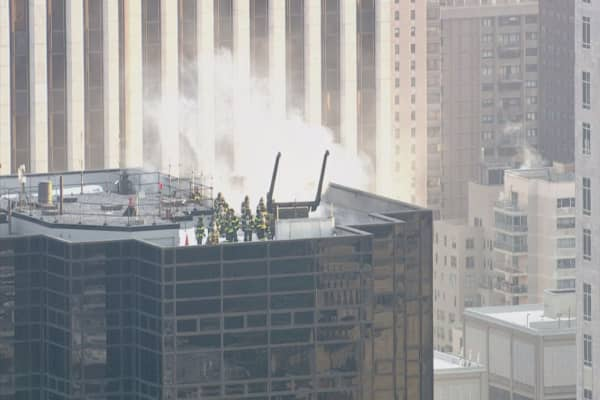 Fire crews are responding to a rooftop fire at Trump Tower