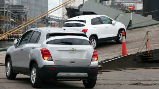 General Motors vehicles are driven up the ramp to a cargo ship at the Port of Veracruz in Veracruz, Mexico.