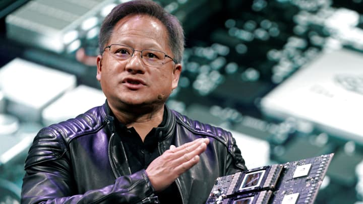 Jensen Huang, CEO of Nvidia, shows the Drive Pegasus robotaxi AI computer at his keynote address at CES in Las Vegas, January 7, 2018.