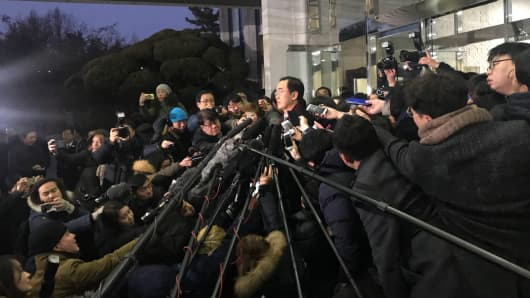 Cho Myoung-gyon, South Korea's minister of unification, speaks with reporters on Jan. 9, 2018 before heading to the border to meet with a North Korean delegation for official talks.