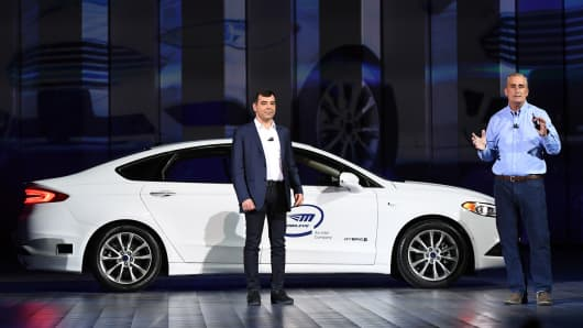 Intel Corp. Senior Vice President and CEO and Chief Technology Officer of Mobileye Amnon Shashua (L) speaks in front of a Ford Fusion with Mobileye autonomous driving technology during a keynote address by Intel Corp.