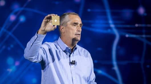 Brian Krzanich, chief executive officer of Intel Corp., holds up a 49-qubit superconducting quantum test chip named 'Tangle Lake' while speaking during a keynote address at the 2018 Consumer Electronics Show (CES) in Las Vegas, Nevada, U.S., on Monday, Jan. 8, 2018.