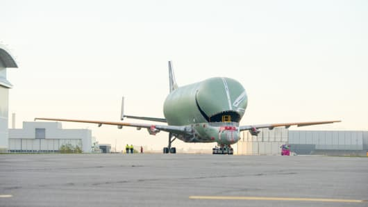 The first structurally complete Airbus BelugaXL transporter rolls out from its assembly hangar in Toulouse.