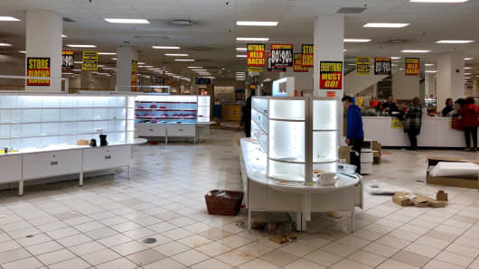 Shoppers search for discounted items left at a Sears store that is closing in South Centre Mall in Calgary.