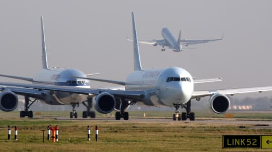 Airplanes queue to take off.