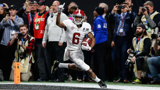 Alabama Crimson Tide wide receiver DeVonta Smith (6) celebrates after making the game-winning catch in overtime the College Football Playoff National Championship Game between the Alabama Crimson Tide and the Georgia Bulldogs on January 8, 2018 at Mercedes-Benz Stadium in Atlanta, GA
