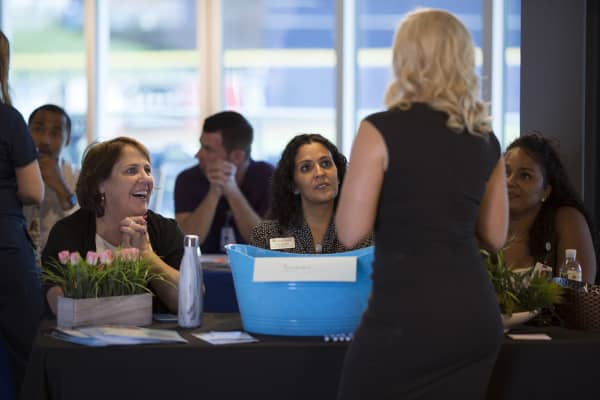 Representatives speak with a job seeker during the West Valley Healthcare Career Expo in Peoria, Arizona.