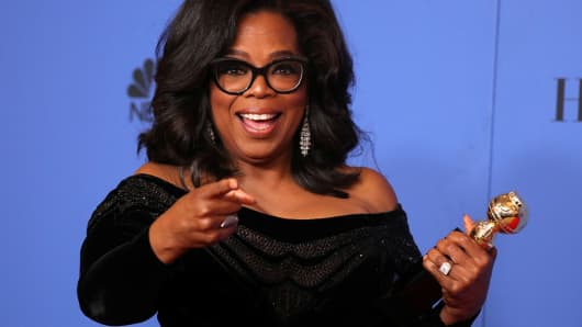 Oprah Winfrey poses backstage with her Cecil B. DeMille Award, January 8, 2018.