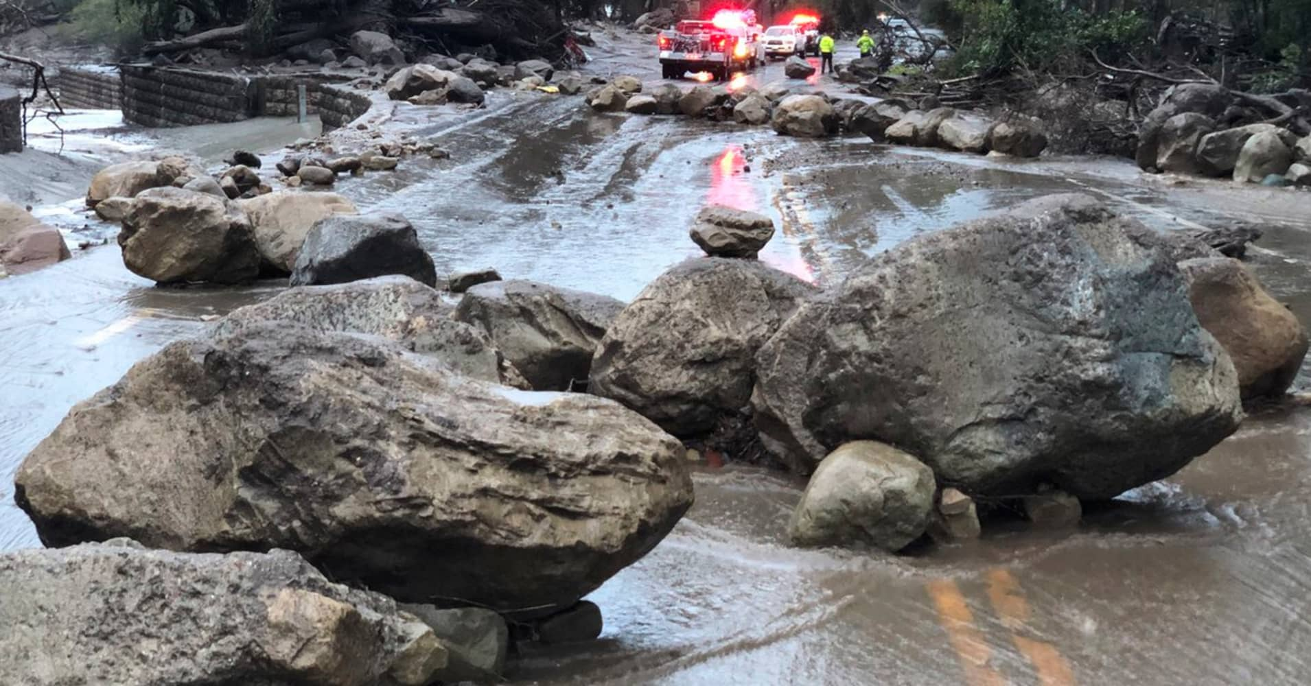 In this photo provided by Santa Barbara County Fire Department, mud and debris flow on the roadway due to heavy rain in Montecito. Calif., Tuesday, Jan. 9, 2018.