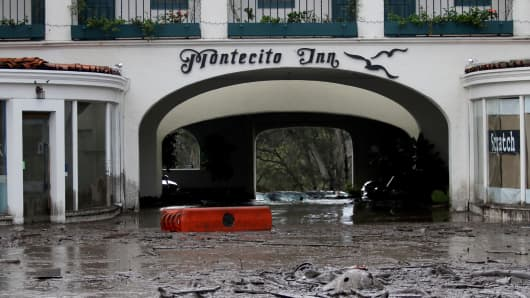 Debris and mud cover the entrance of the Montecito Inn after heavy rain brought flash flooding and mudslides to the area in Montecito, Calif. on Tuesday, Jan. 9, 2018.