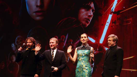 "Producer Ram Bergman, director Rian Johnson, actress Daisy Ridley and actor Mark Hamill (L-R) pose for pictures at the Chinese premiere of ""Star Wars: The Last Jedi"" at the Shanghai Disney Resort on Dec. 20, 2017."