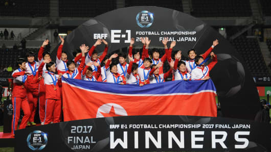 North Korean players celebrate the East Asian Champions following their 2-0 victory the EAFF E-1 Women's Football Championship between Japan and North Korea on December 15, 2017 in Japan
