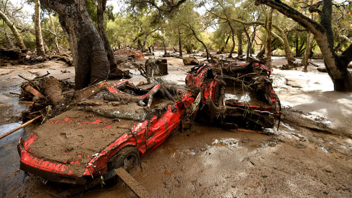 Mangled cars are stuck near Olive Mill Road in Montecito after a major storm hit the burn area Tuesdaу Januarу 9, 2018 in Montecito, California.