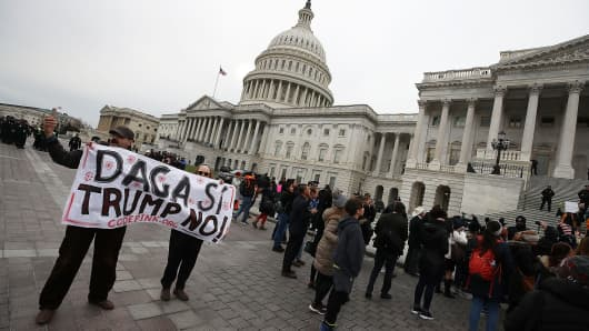 Folks scream in entrance of the U.S. Capitol to induce Congress to effect the Deferred Shuffle for Childhood Arrivals (DACA) program on December 6, 2017, in Washington, D.C.