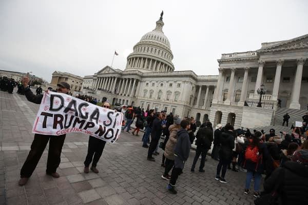 People protest in front of the U.S. Capitol to urge Congress to save the Deferred Action for Childhood Arrivals (DACA) program on December 6, 2017, in Washington, D.C.
