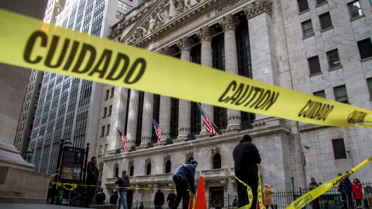 Yellow 'Caution' tape is displayed outside of the New York Stock Exchange (NYSE) in New York.