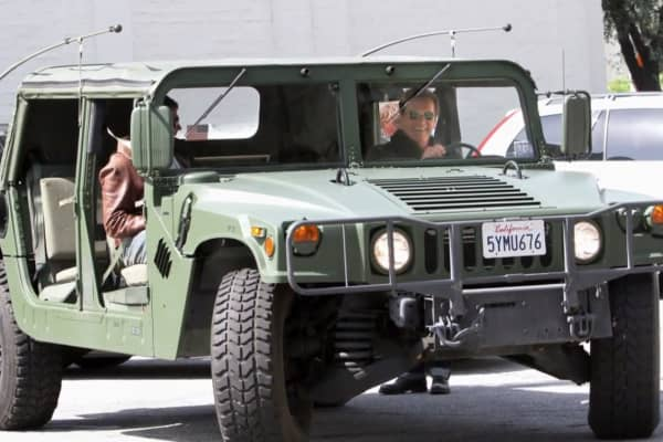Arnold Schwarzenegger in one of his hummers