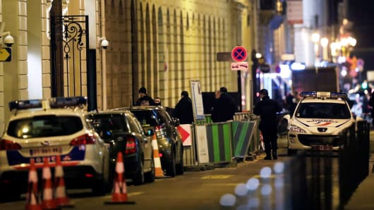 Police stand in rue Cambon at the back entrance of the Ritz luxury hotel in Paris