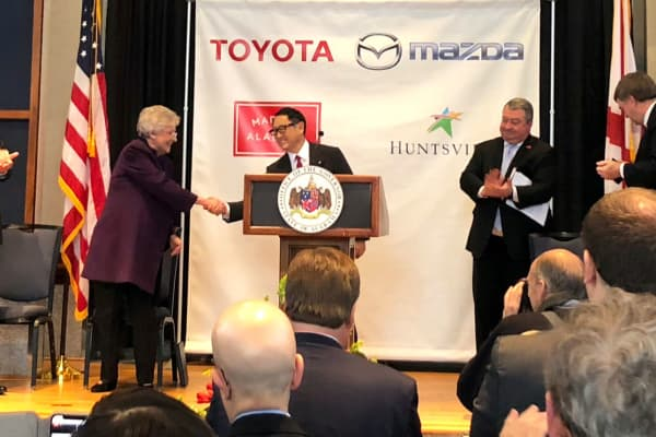 Alabama Governor Kay Ivey shakes hands with the president of Toyota Motor Company Akio Toyoda at an event to announce the building of a $1.6 billion joint venture assembly plant with Mazda in Alabama, in Montgomery, Alabama, January 10, 2018.