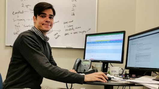 Researcher Nick Rizzutti at his computer.