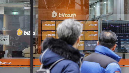 A screen shows the prices of bitcoin at a virtual currency exchange store in Seoul, South Korea.