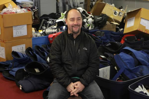Eric Fanelli has cut down on his time playing in two hockey leagues to focus on his side hustle as a hockey equipment reseller.