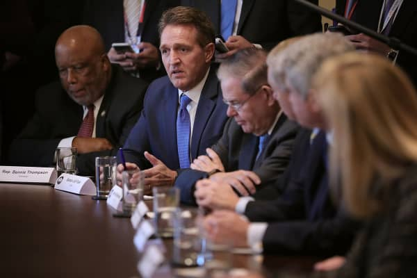 Republican and Democrat members of Congress, including (L-R) Rep. Bennie Thompson (D-MI) Sen. Jeff Flake (R-AZ), Sen. Robert Menendez (D-NJ) and others, join President Donald Trump for a meeting on immigration in the Cabinet Room at the White House January 9, 2018 in Washington, DC.