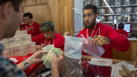 A customer buys cannabis products at MedMen, one of the two Los Angeles area pot shops that began selling marijuana for recreational use under the new California marijuana law today, on January 2, 2018 in West Hollywood, California. Los Angeles and other nearby cities outside of West Hollywood have not finalized their local permitting rules so licenses to businesses in those jurisdictions are yet to be granted.