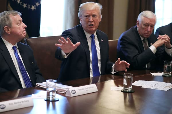 President Donald Trump (C) presides over a meeting about immigration with Republican and Democrat members of Congress, including Senate Minority Whip Richard Durbin (D-IL) (L) and House Minority Whip Steny Hoyer (D-MD) in the Cabinet Room at the White House January 9, 2018 in Washington, DC.