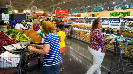 Customers browse produce during the grand opening of the Lidl Ltd. store in Virginia Beach, Virginia.